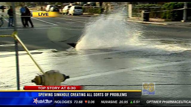 Spewing sinkhole creates all sorts of problems