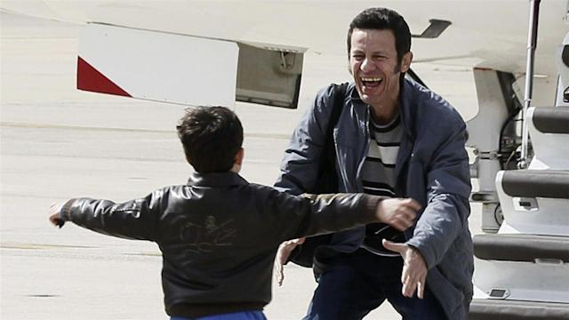 Photos of the Day – Freed Reporter Greeted By Son