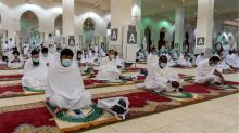 In Mecca, a fortunate few pray for a pandemic-free world