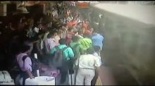 Police officers rush to save passengers who fell off moving train in Mumbai
