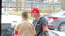 Woman squares off with couple wearing Nazi regalia at Holocaust memorial