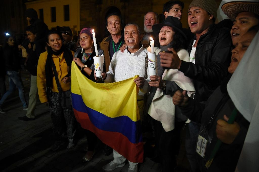 People celebrate on Bogota's main square, November 12, 2016, after the Colombian government and Marxist FARC rebels signed a new and revised peace deal to end 52 years of civil war (AFP Photo/Guillermo Legaria)