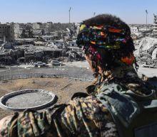 Fighters in Syria's Raqa prepare for civilian handover