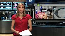 MoneyWatch: Dow falls below 17k; Walmart opens to US manufacturing