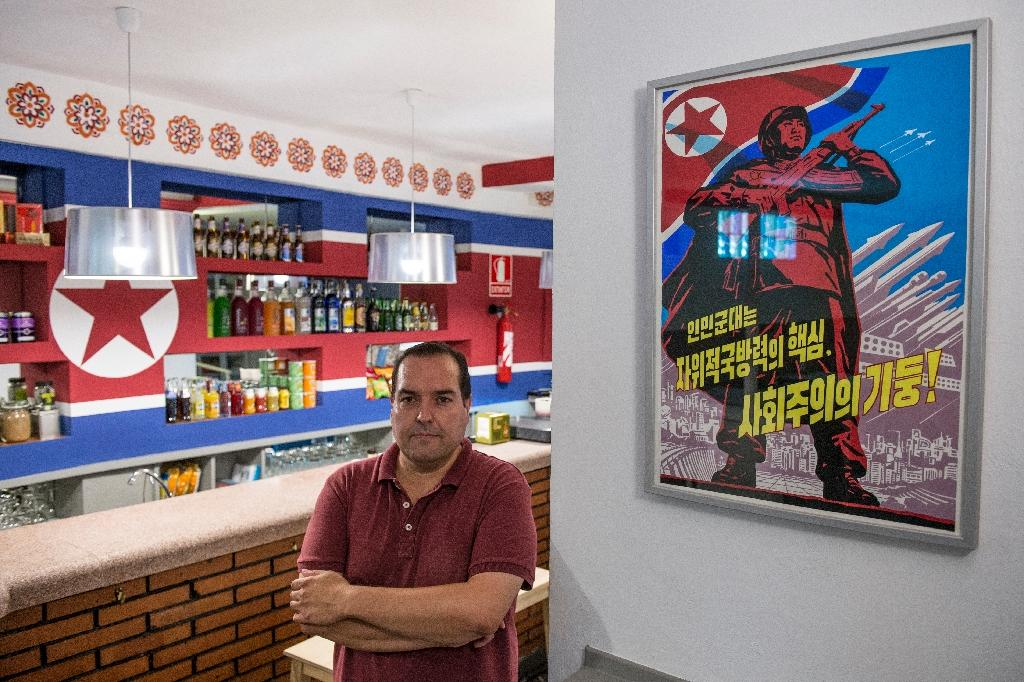 The Pyongyang Cafe was founded to promote the controversial socialist regime of Kim Jong-Un (AFP Photo/Josep Lago)