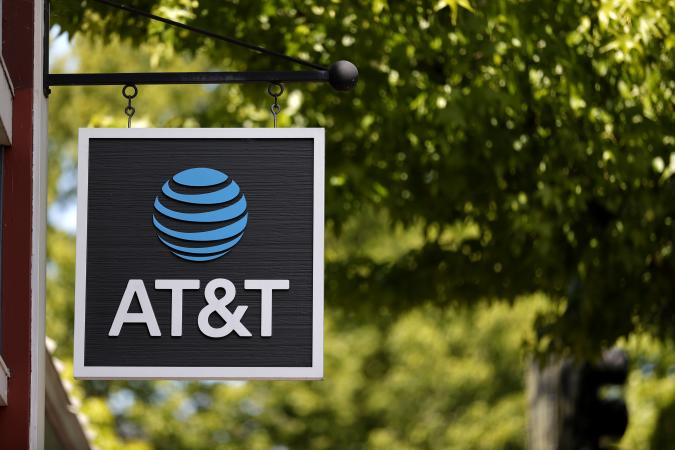 SAN RAFAEL, CALIFORNIA - MAY 17: A sign is posted in front of an AT&T retail store on May 17, 2021 in San Rafael, California. AT&T,  the world's largest telecommunications company, announced a deal with Discovery, Inc. which will spin off AT&T's WarnerMedia and be combined with Discovery to create a new standalone media company. (Photo by Justin Sullivan/Getty Images)