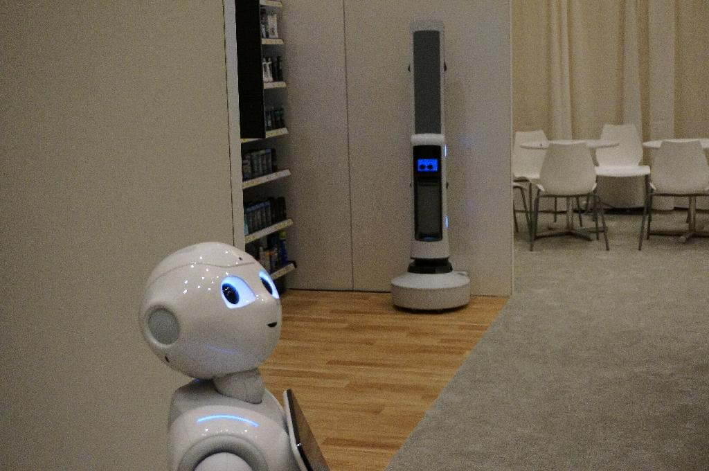 Pepper, of SoftBank Robotics, can use facial recognition to personally greet customers in stores or hotels (AFP Photo/Robert LEVER)