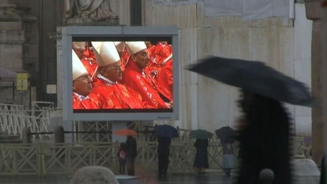 Suspense in St Peter's as thousands watch conclave