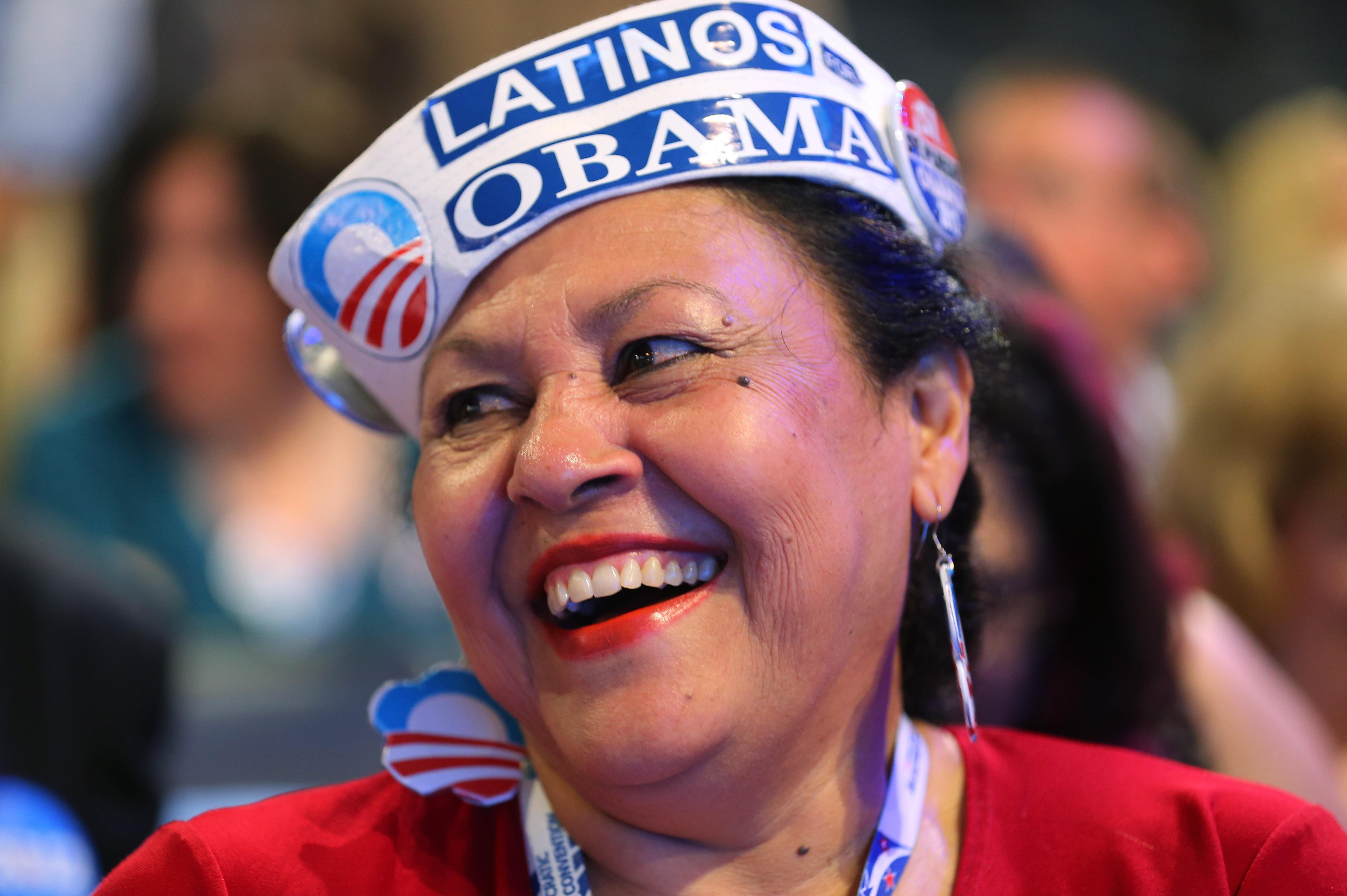 Delegate Antonia Gonzalez of Seattle, WA wears a Latinos for Obama hat during day one of the Democratic National Convention at Time Warner Cable Arena on September 4, 2012 in Charlotte, North Carolina. The DNC that will run through September 7, will nominate U.S. President Barack Obama as the Democratic presidential candidate. (Photo by Joe Raedle/Getty Images)