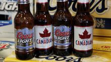 Molson Coors beats on earnings, Netflix poaches Fox producer, Chipotle grabs Taco Bell CEO, Tesla has issues in China