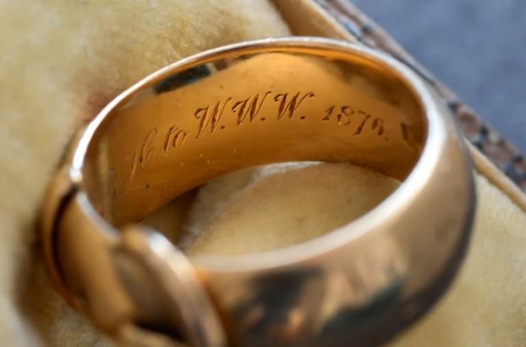 "The ring bears the inscription in Greek that says ""Gift of love, to one who wishes love."" It also has the initials of: ""OF OF WW + RRH to WWW"" (AFP Photo/JOHN THYS)"