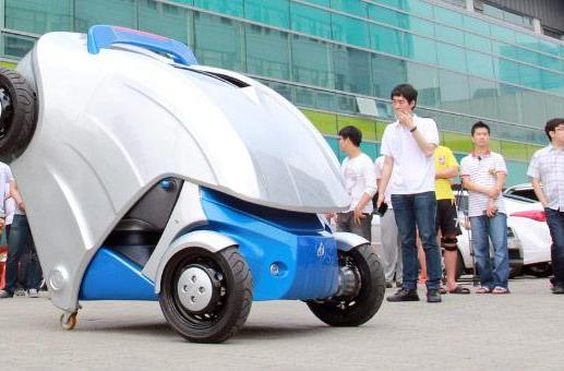 Armadillo-T micro electric car folds to fit into compact parking spaces (video)