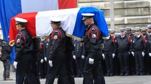 Macron, Le Pen attend ceremony for slain policeman