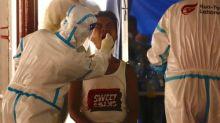 Hong Kong ponders lockdown amid latest coronavirus outbreak