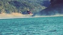 Helicopter Loads Up Water to Battle Northern California Wildfires