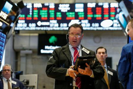 Wall Street briefly pares losses after Fed decision
