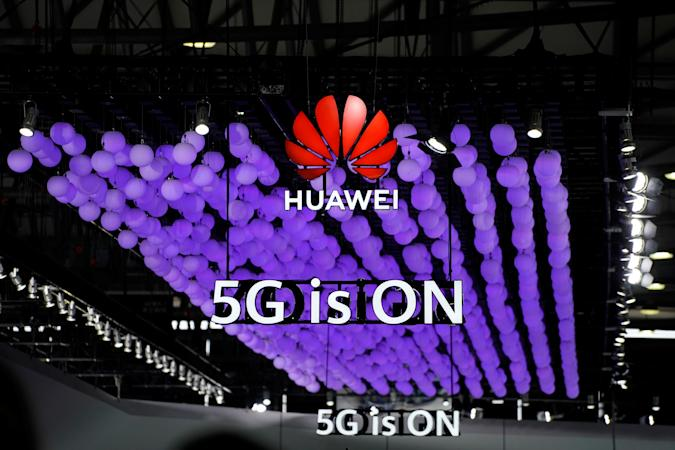 A Huawei logo and a 5G sign are pictured at Mobile World Congress (MWC) in Shanghai, China June 28, 2019. REUTERS/Aly Song