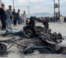 Afghan school blast toll rises to 58, families bury victims