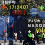 Global stocks shrug off U.S. shutdown, dollar dips