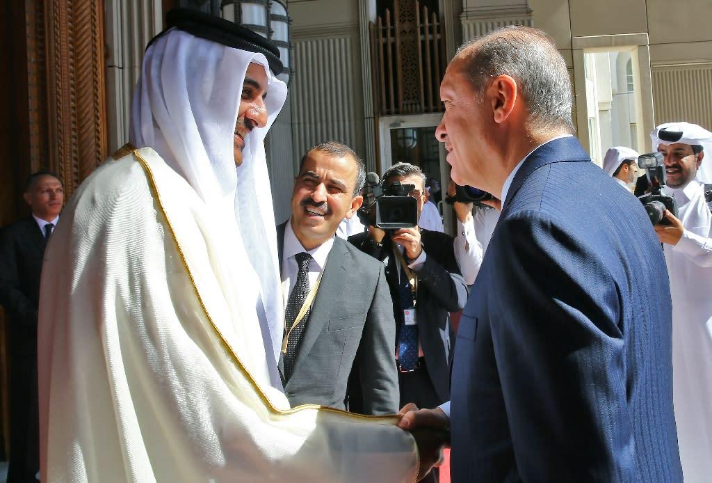 Turkish President Recep Tayyip Erdogan is welcomed in Doha by Qatar's Emir Sheikh Tamim bin Hamad al-Thani