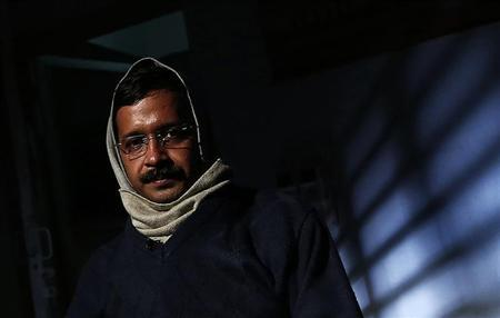 Delhi's CM Kejriwal, chief of AAP poses before the start of an interview with Reuters at his residence on the outskirts of New Delhi