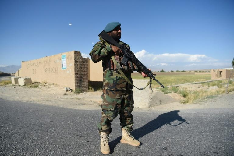 At least 18 Afghan security force members were killed in two Taliban attacks (AFP Photo/WAKIL KOHSAR)