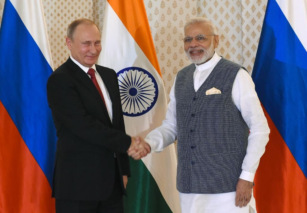 Indian Prime Minister Narendra Modi (right) shakes hands with Russian President Vladimir Putin ahead of the Indo-Russia Annual Summit in Goa on October 15, 2016 (AFP Photo/Prakash Singh)