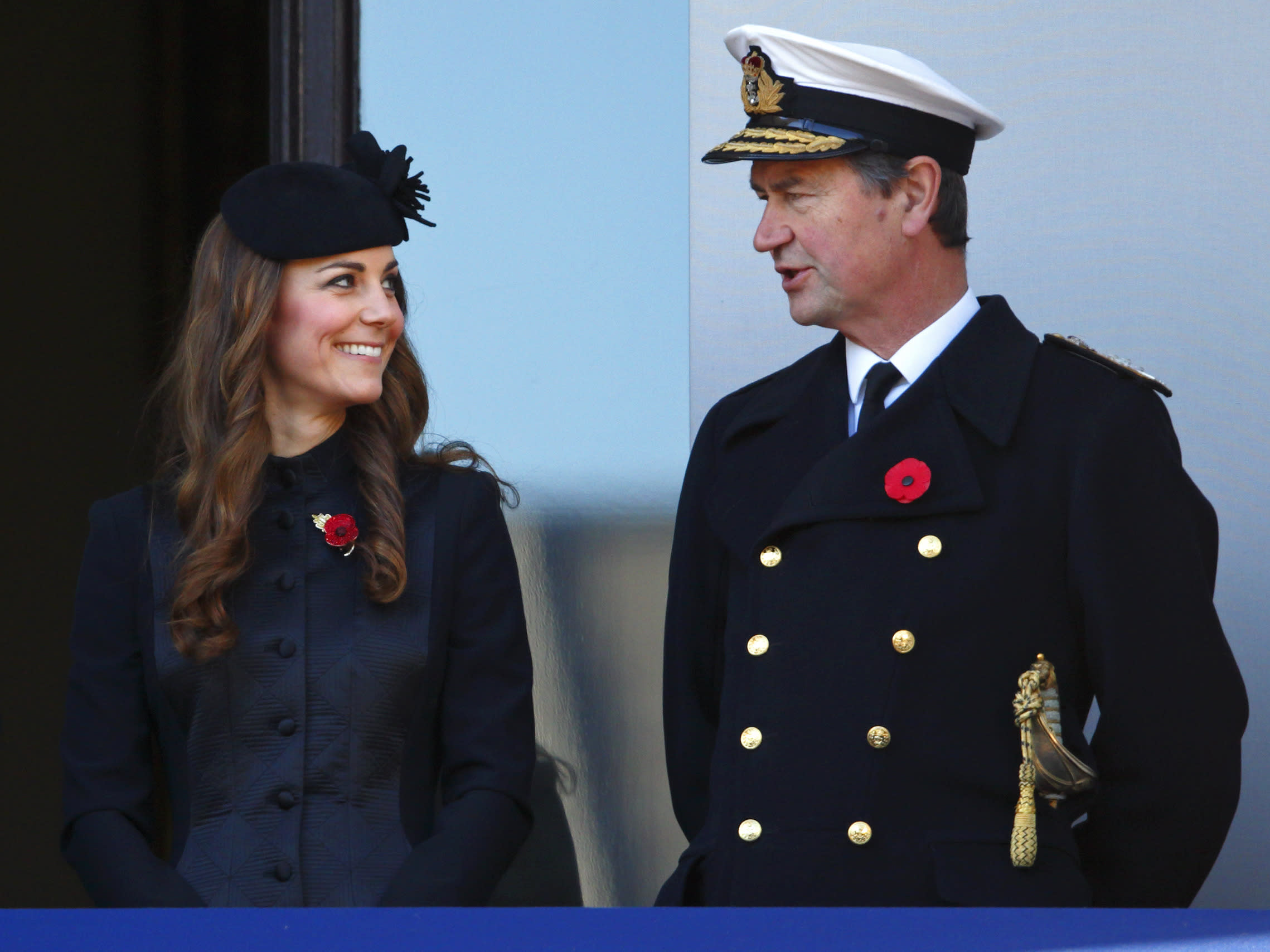 Kate wore a pretty black Temperley coat to honor Remembrance Day in London, wearing her hair in ringlets.
