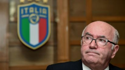 Former Italian football head denies harassment
