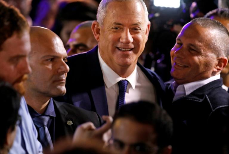 Blue and White's leader, ex-military chief Benny Gantz (C), admitted 'disappointment' with the result (AFP Photo/Menahem KAHANA)