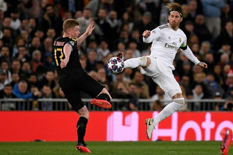 Sergio Ramos challenges Kevin De Bruyne in the first leg of Real Madrid's tie against Manchester City. De Bruyne's late penalty gave City a 2-1 win in Spain (AFP Photo/PIERRE-PHILIPPE MARCOU)
