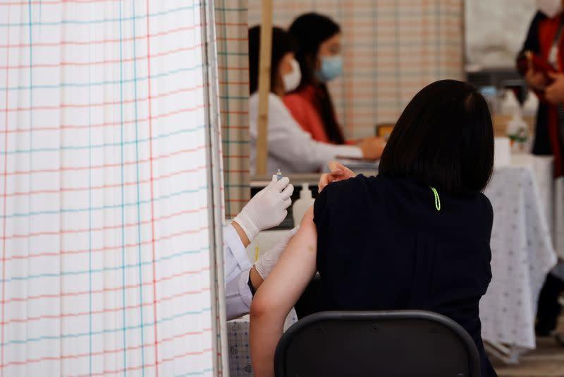 South Korea finds no link between flu shot, boy's death as toll rises