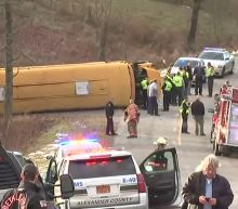 Woman charged in school bus crash injuring 13 students
