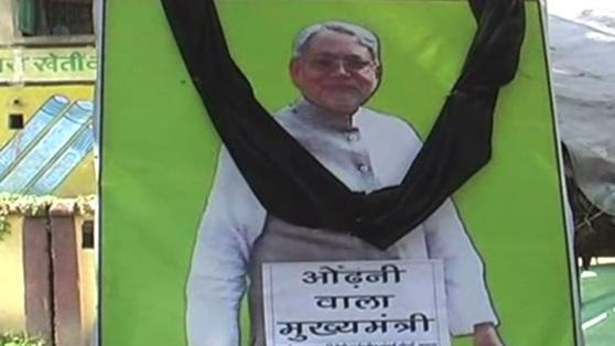 Women forced to take off burqa, dupatta demand apology from Nitish