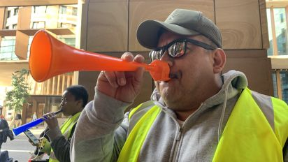 Sirens, horns, and yellow vests at London WeWork protest