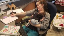 Photo of multitasking mum with baby at work goes viral