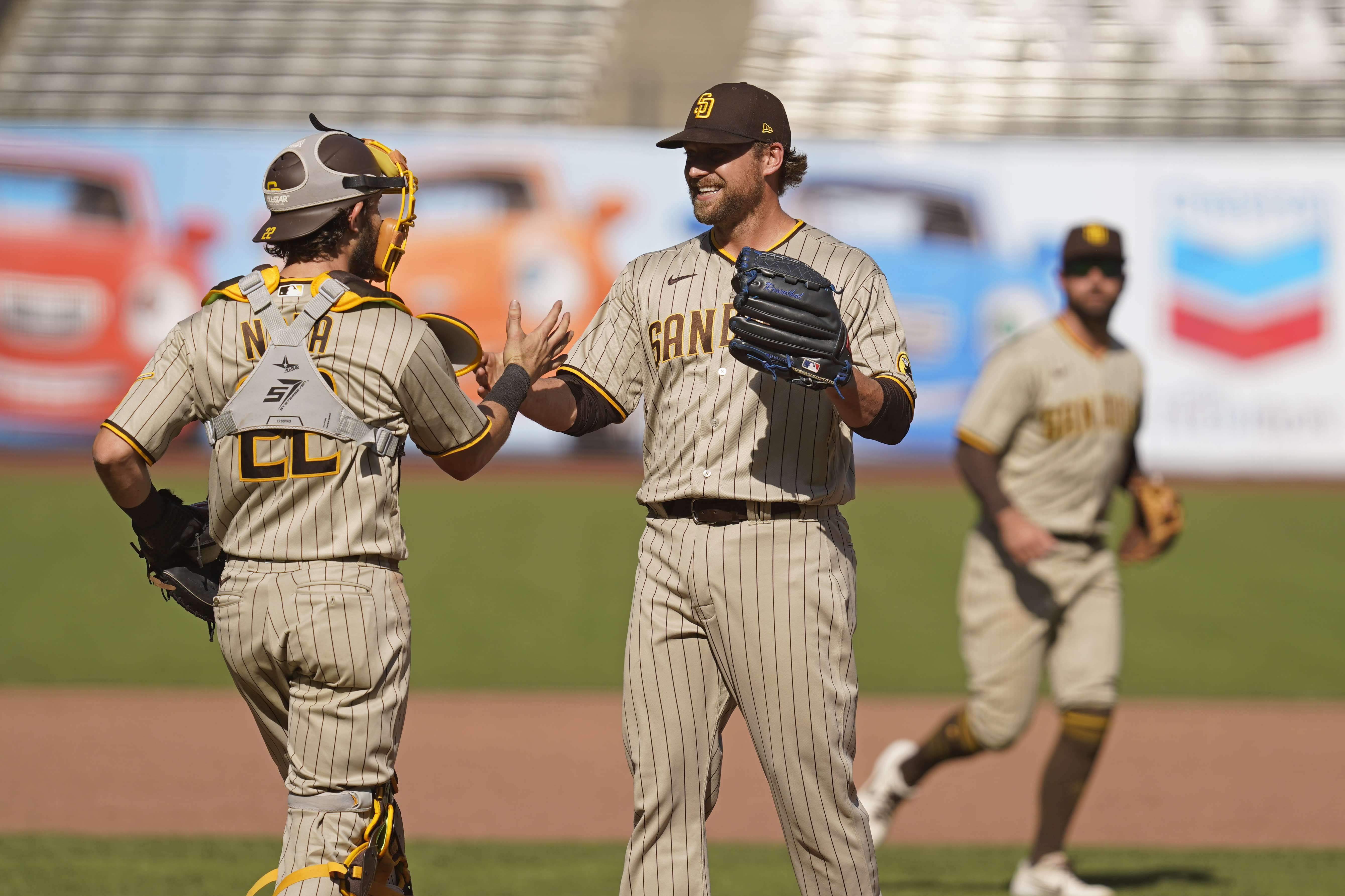 San Diego Padres relief pitcher Trevor Rosenthal, front right, is greeted by catcher Austin Nola at the end of a baseball game against the San Francisco Giants, Sunday, Sept. 27, 2020, in San Francisco. (AP Photo/Eric Risberg)