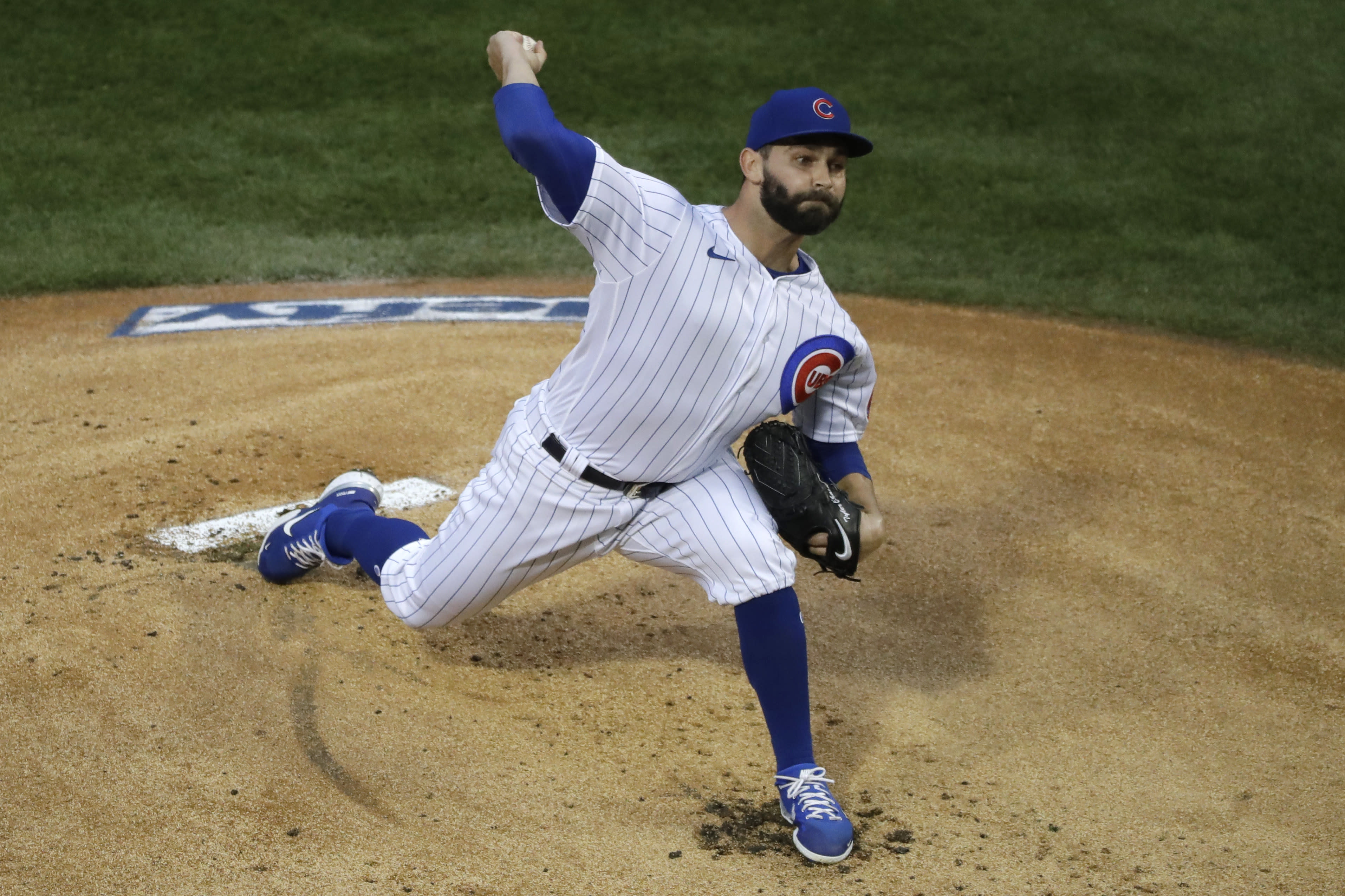Chicago Cubs starting pitcher Tyler Chatwood throws to aPittsburgh Pirates batter during the first inning of a baseball game in Chicago, Saturday, Aug. 1, 2020. (AP Photo/Nam Y. Huh)