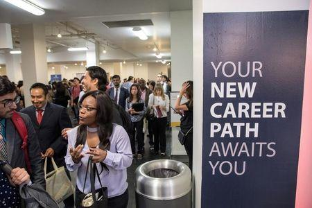 FILE PHOTO: Job seekers and recruiters gather at TechFair in Los Angeles, California, U.S. March 8, 2018. REUTERS/Monica Almeida