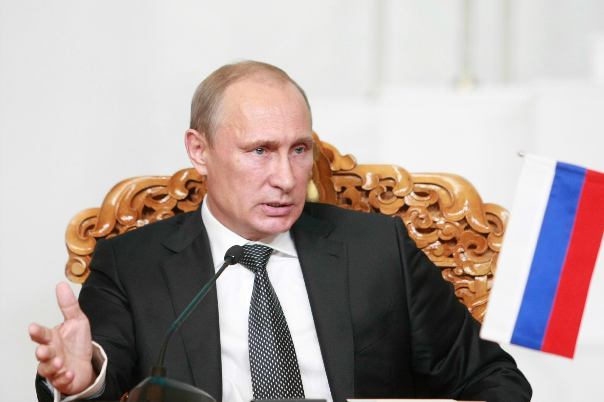 Russian President Vladimir Putin gestures as he talks on September 3, 2014