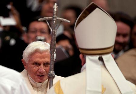 FILE PHOTO: Pope Francis (R) greets former Pope Benedict during a consistory ceremony in Saint Peter's Basilica at the Vatican February 22, 2014. REUTERS/Alessia Giuliani/File Photo