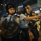 The Latest: Hong Kong police confirm warning shot, arrest 36