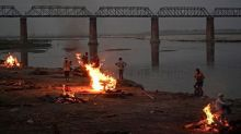 India Covid: Dozens more bodies wash up on Ganges river bank