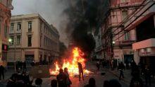 Tres muertos y toque de queda en tres regiones por graves disturbios en Chile