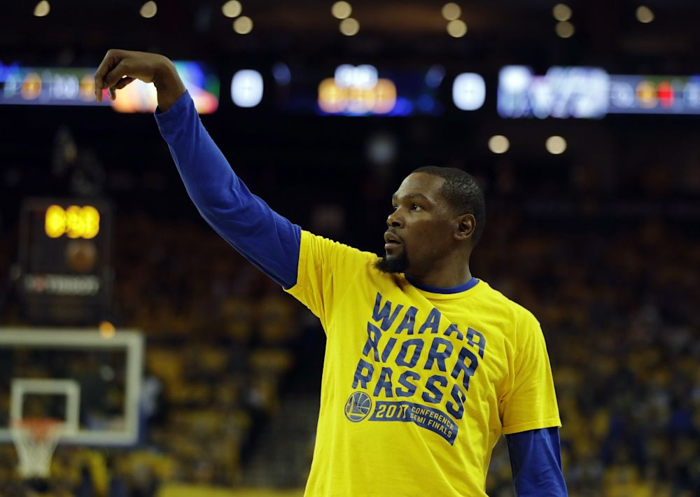 Kevin Durant has a player option for next season that's worth $27.7 million. (AP)