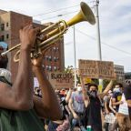 Detroit's largely peaceful protests seen very differently from white suburb
