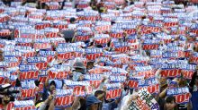 Tens of thousands rally for removal of US base off Okinawa