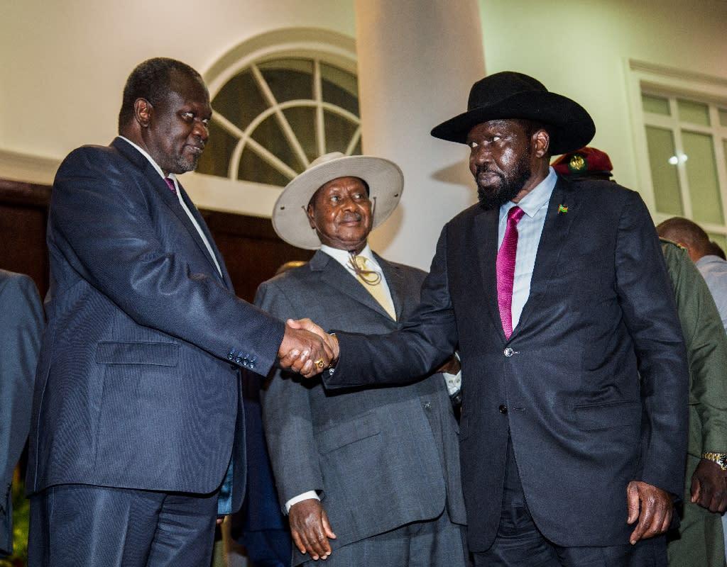 South Sudan's President Salva Kiir, right, shakes the hand of rebel leader Riek Machar in July