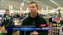 Shoppers stock up on staples before storm