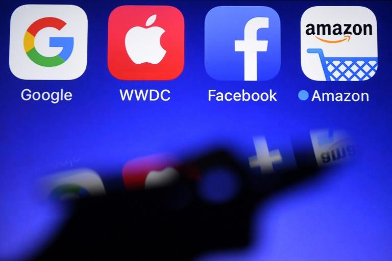 This file photo shows the logos of the four giant tech firms whose heads will testify before the US Congress on July 29, 2020, amid rising pushback against their market dominance (AFP Photo/Damien MEYER)